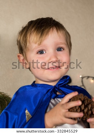 Pretty smiling child in New Year suit with bump in hands