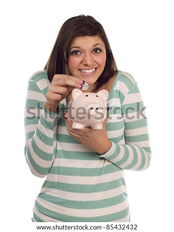 Pretty Smiling Ethnic Female Putting a Coin Into Her Pink Piggy Bank Isolated on a White Background. - stock photo