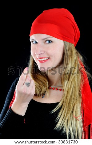 Pretty smiling fortuneteller calls to her, on black background - stock photo