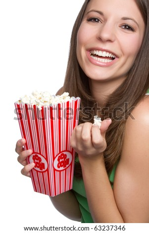 Pretty smiling girl eating popcorn - stock photo