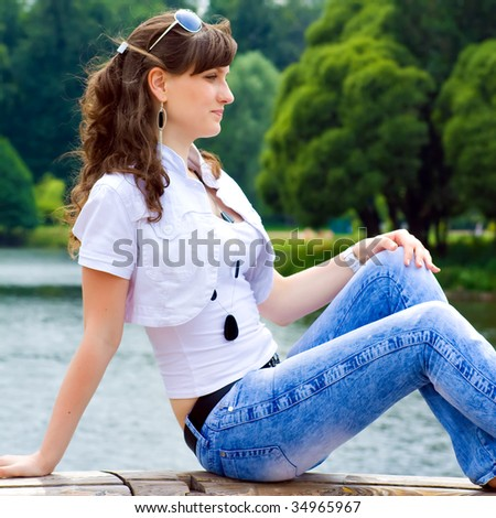 Pretty smiling girl sitting on bench