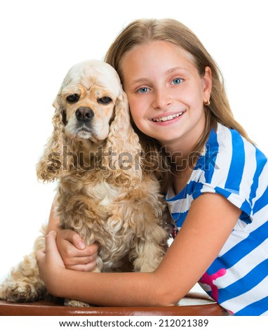 Pretty smiling girl with american spaniel on a white background