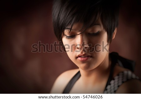 Pretty Smiling Multiethnic Young Adult Woman Portrait with Selective Focus.