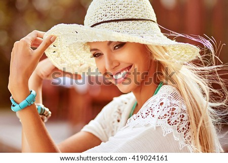 Pretty smiling summer woman in hat - close up - stock photo