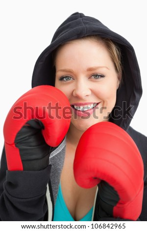Pretty smiling woman boxing against white background - stock photo