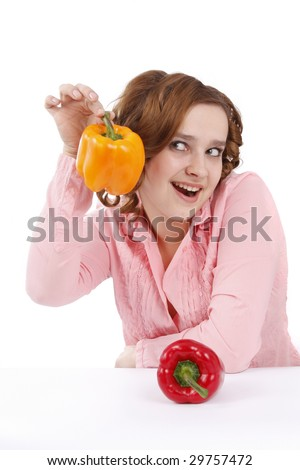 Pretty smiling woman holding a red sweet pepper. Woman wants to eat sweet peppers. Girl is looking surprised. Housewife wants to eat sweet peppers. Isolated over white background - stock photo