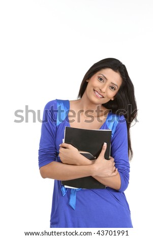 Pretty smiling woman holding books - stock photo