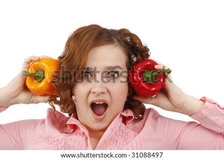 Pretty smiling woman holding sweet peppers. Beautiful young woman with fresh vegetables. Housewife with sweet peppers. Isolated over white background. - stock photo
