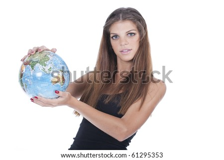 Pretty smiling woman holding the world globe in her hands