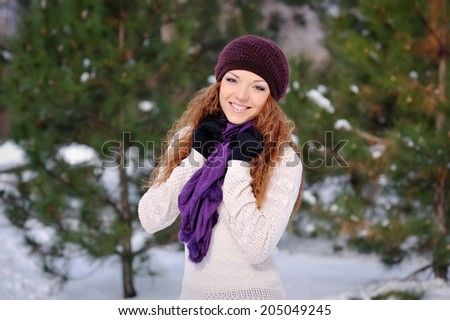 pretty smiling woman portrait outdoor in winter