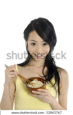 Pretty smiling woman with food - stock photo