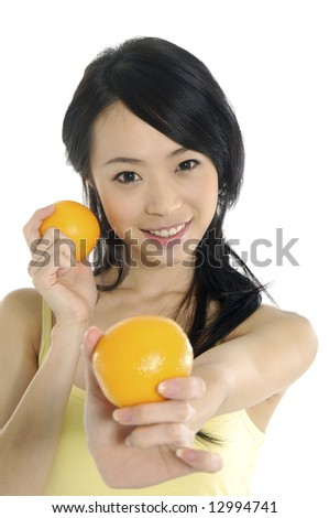 Pretty smiling woman with orange - stock photo