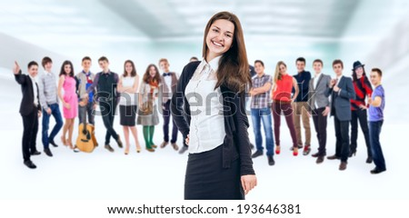 Pretty smiling young girl with her friends - stock photo
