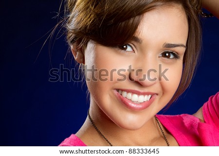 Pretty smiling young hispanic girl - stock photo
