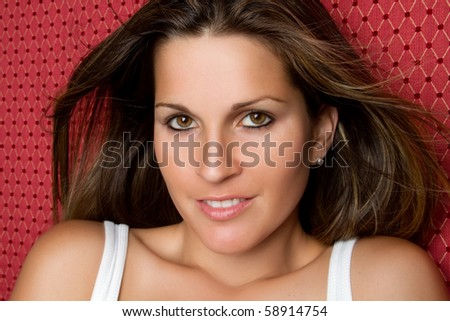 Pretty smiling young woman closeup - stock photo