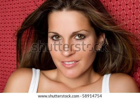 Pretty smiling young woman closeup - stock photo
