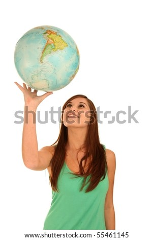 Pretty smiling young woman spinning the globe on her hand