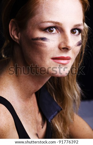 pretty soldier woman with camouflage on face - stock photo