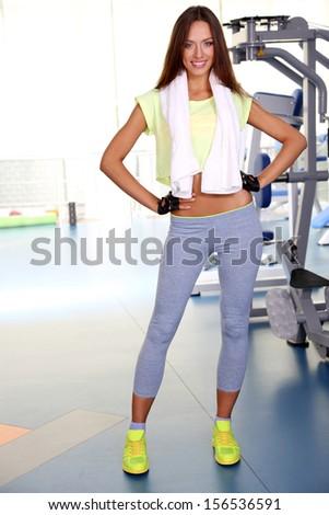 Pretty sporty girl in gum - stock photo