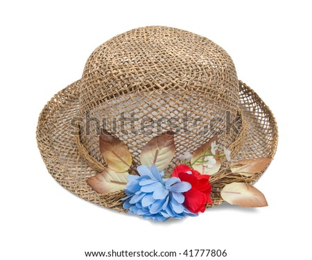 Pretty straw hat with flower on white background
