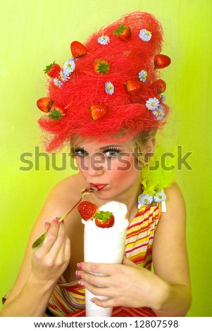 Pretty strawberry girl eating sweet cream - stock photo