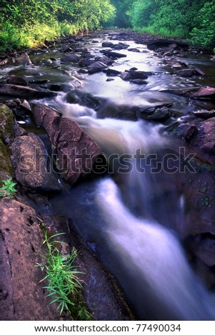Pretty stream in the Porcupine Mountains Wilderness State Park of Michigan - stock photo