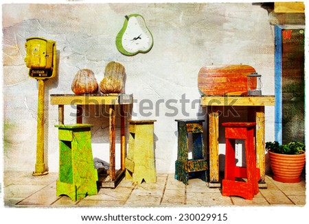 pretty street bar with tables and chairs, artistic picture - stock photo