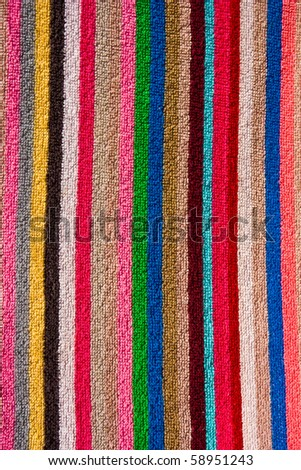 Pretty striped beach towel useful as a background pattern