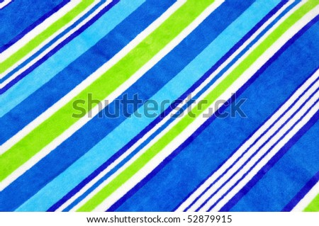 Pretty striped Beach Towel useful as a background texture or pattern - stock photo