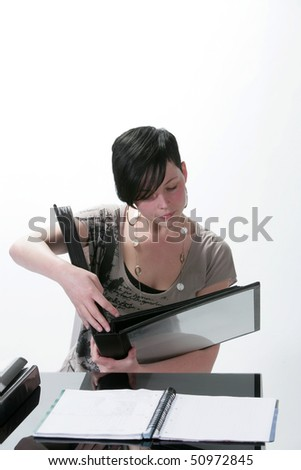 Pretty student making revisions isolated in a white background
