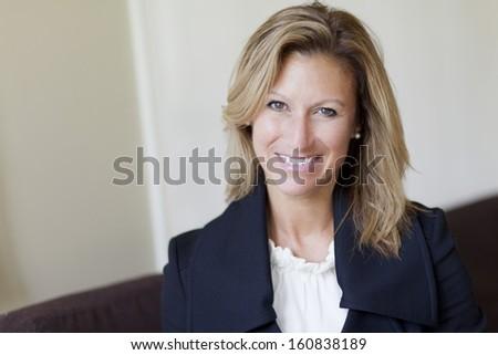 Pretty Successful Businesswoman at Home - stock photo