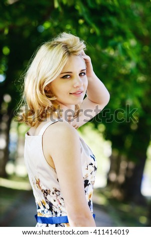 pretty summer lady in the green park - stock photo