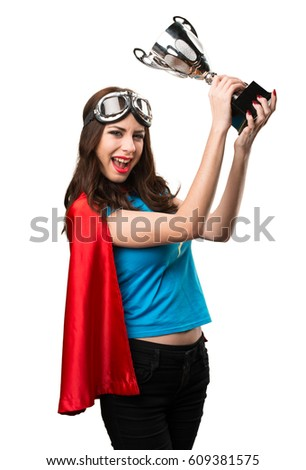 Pretty superhero girl holding a trophy
