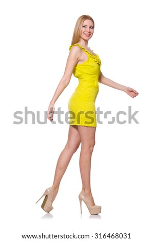 Pretty tall woman in short yellow dress isolated on white - stock photo