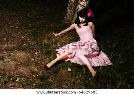 pretty teen alone in the forest, may be use for sad, halloween or dead concept - stock photo