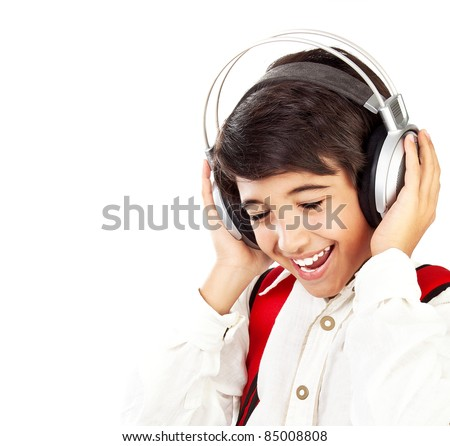 Pretty teen boy enjoying music, holding head with headphones, expressing pleasure and having fun, singing a song - stock photo