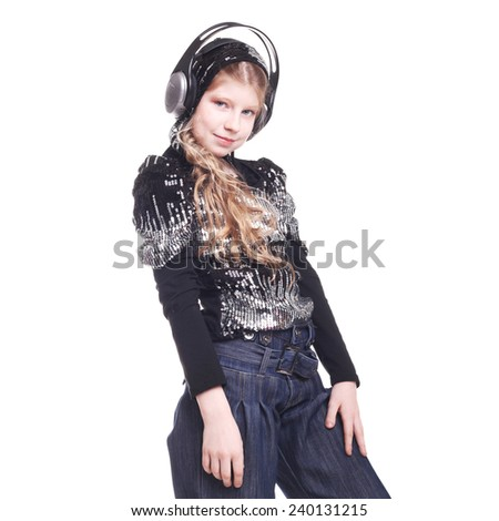 pretty teen girl dancing in headphones in studio - stock photo