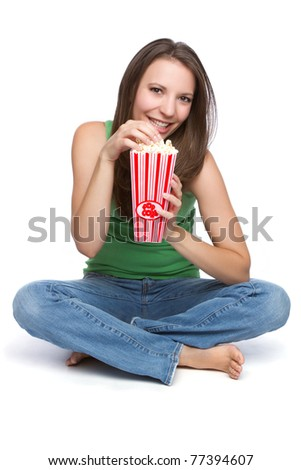 Pretty teen girl eating popcorn - stock photo