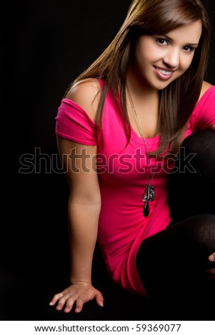 Pretty teen girl sitting down - stock photo