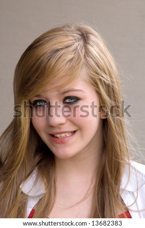 Pretty teen girl smiling brightly
