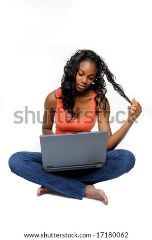 Pretty Teen Girl Surfing The Internet Sat On The Floor, Isolated With Copyspace - stock photo