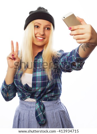 pretty teen girl wearing hat, taking selfies