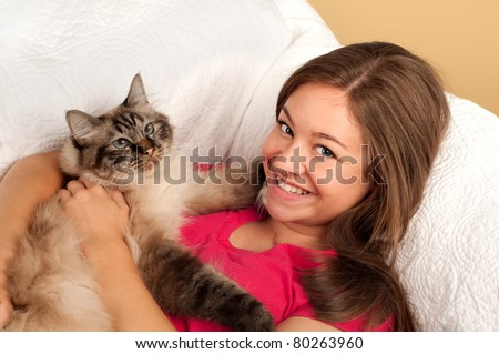 Pretty Teen Girl with Her Kitty - stock photo
