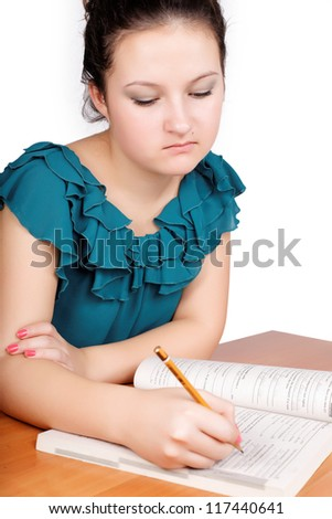 pretty teen schoolgirl studying for school isolated