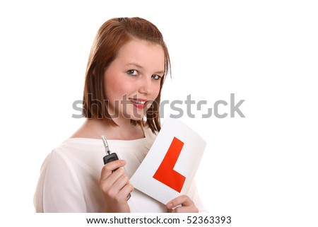 Pretty teenage driver holding L-plates and car key. - stock photo