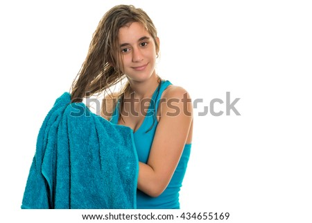 Pretty teenage girl drying her wet hair  with a towel - Isolated on a white background