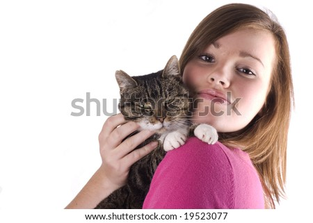 Pretty teenage girl holding her cat, isolated on a white background. - stock photo