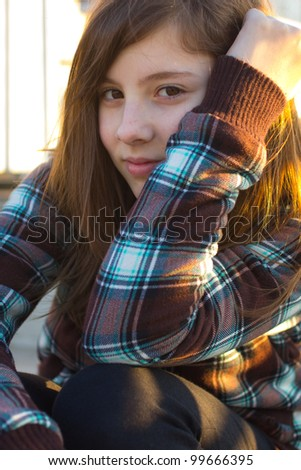 Pretty teenage girl in afternoon light - stock photo