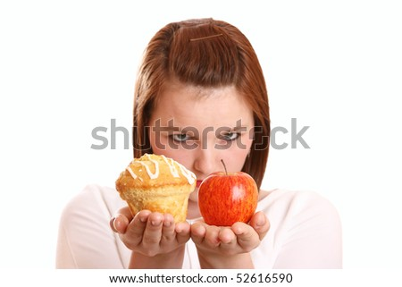 Pretty teenage girl thinking about dietary choices - stock photo