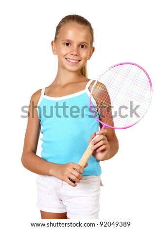 Pretty teenage girl with racket in studio on white background - stock photo